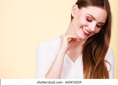 Positive emotions, natural beauty, face expressions concept. Attractive happy smiling woman in brown hair and full makeup