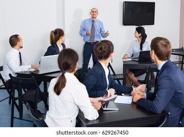 Positive employeesin office on business meeting