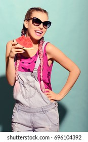 Positive energy from beautiful young woman. Summer portrait with watermelon.