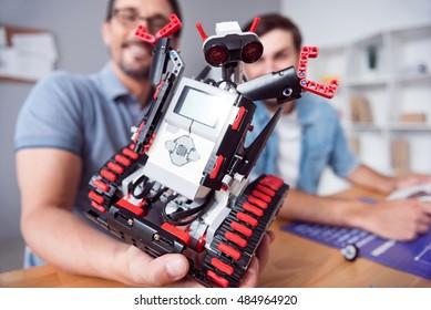 Positive engineer holding robot