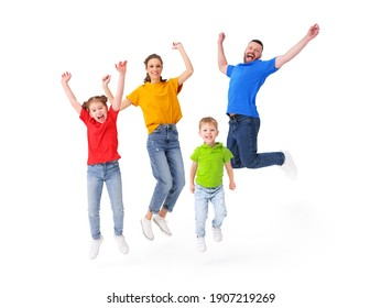 Positive family: couple and kids jumping with outstretched arms above ground in studio on white background while having fun and celebrating victory