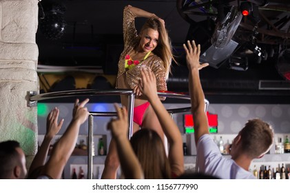 Positive germany gogo dancer woman dancing in the night club on holiday
