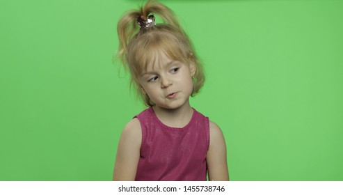 Positive girl in purple dress. Pretty little blonde child. Make faces. Place for your logo or text. Green screen. Chroma Key