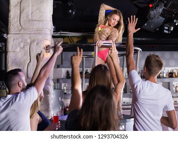 Positive gogo dancer woman dancing at the night club on holiday