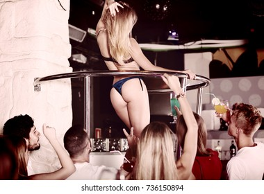 Positive gogo dancer woman dancing in the night club on holiday