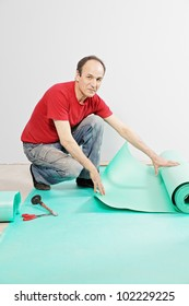 Positive guy in red shirt with sub-flooring mat