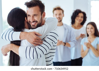 Positive happy people hugging each other