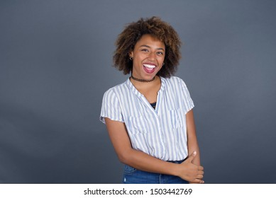 Positive human facial expressions and emotions. Isolated shot of attractive African American girl looking and smiling broadly at camera during nice conversation with someone.
