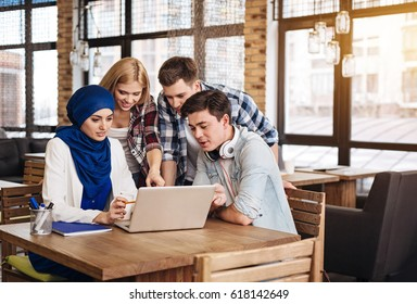 Positive international students working together