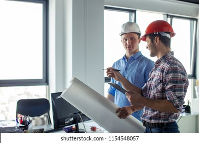 positive leader in casual outfit of the team giving tasks to the worker. side view photo. copyspace