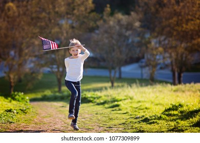 positive little boy with american flag running and celebrating 4th of july, independence day, or memorial day