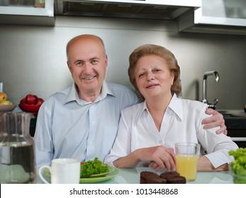 Positive loving aged coupel having breakfast,lunch,dinner