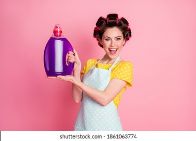 Positive maid hold chemical detergent wash powder wear yellow dotted t-shirt isolated on pastel color background