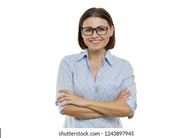 Positive mature woman on white isolated background. Confident female smiling arms crossed, businesswomen, specialist, expert.