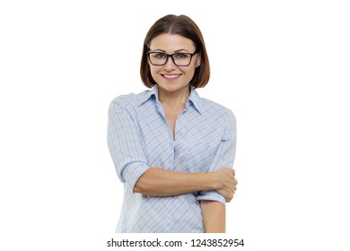Positive middle-aged woman posing with hands on white background, isolated.