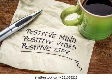 positive mind,  positive vibes, positive life - motivational handwriting on a napkin with a cup of coffee