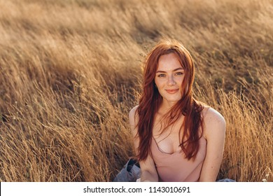 Positive natural close up portrait of young gorgeous caucasian ginger girl with freckles. Healthy lifestyle, beauty, natural concept