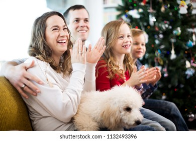 Positive parents and children happy to spend Christmas together at home