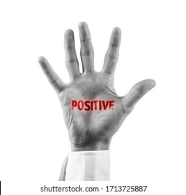 Positive patient stigma concept. Hand with red text positive. Symbolism of stigma in pandemic times like covid-19.