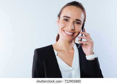 Positive pleasant woman making a call