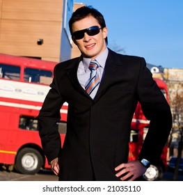 Positive portrait of young businessman outdoors