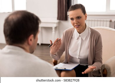 Positive professional therapist giving advice