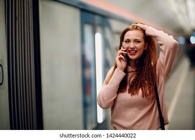 Positive redhead girl portrait at   Moscow metro subway.