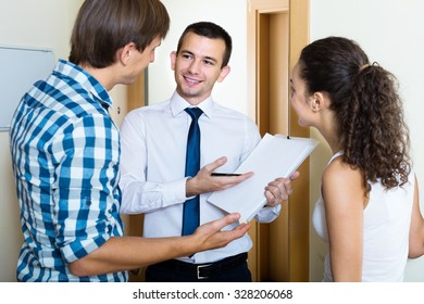 Positive salesman in hall forcing family to buy subscriptions