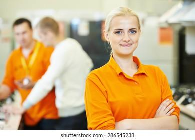 Positive seller or shop assistant portrait  in supermarket store