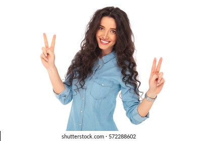 positive smiling casual woman making victory sign on white background
