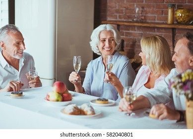 Positive smiling family sitting at the table