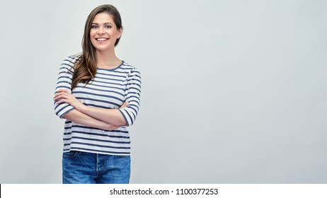 Positive smilling woman wearing striped shirt studio isolated portrait.