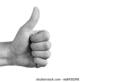 Positive symbol on white isolated background. Hand showing the thumb that is ok.