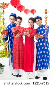 Positive Vietnamese congratulating with Tet �¢?? the traditional celebration of New Year