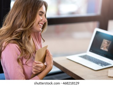 Positive woman holding letter