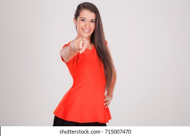 positive woman points her finger and smiles