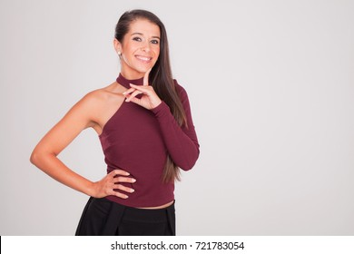 positive woman raises her fingers and smiles