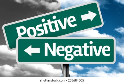 Positive x Negative creative sign with clouds as the background