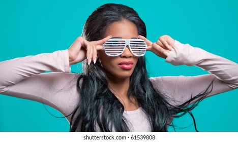 Positive young black woman, wearing fancy shutter shades sunglasses