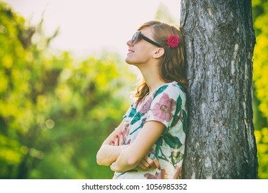 Positive young woman enjoying in the nature.