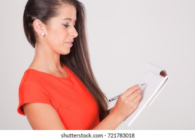 Positive young woman notebook