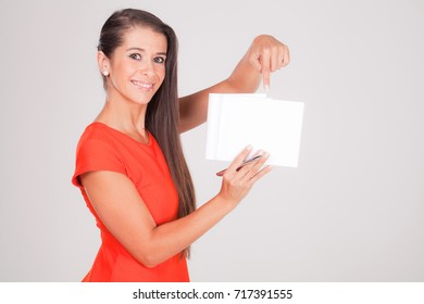 positive young woman, points to notebook