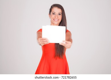 Positive young woman, smiles at notebook
