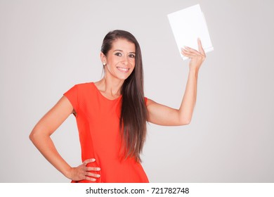 Positive young woman. smiles at notebook.
