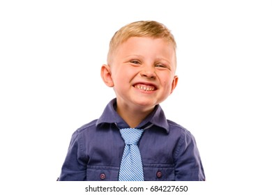 Positively Teeth Smiling Baby Boss. Blond hair and bright eyes. Dressed in dark blue shirt with striped tie. Isolated background.
