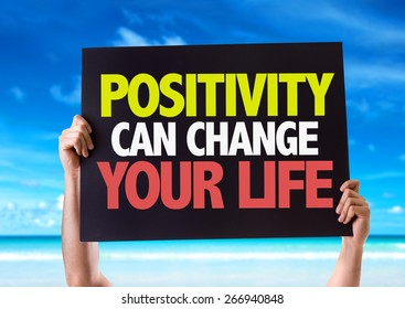 Positivity Can Change Your Life card with beach background