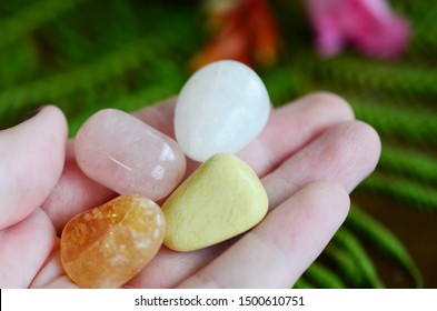 Positivity Crystals, Mindfulness. Tumbled Crystal Bundle: Rose Quartz, Citrine, Serpentine, and Milky Quartz. Energy Spring Cleaning. Variety of healing crystals, pastel colors in natural lighting