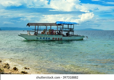 Poso, Indonesia - Dec 13, 2015: Tourist boat on the beach near Poso city.  Central Sulawesi. Indonesia