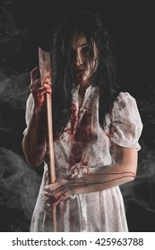 Possessed Bloody Woman holding an axe