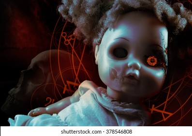 Possessed demonic doll. Possessed demonic horror doll with red pentacles, glowing eye & human skull on background.